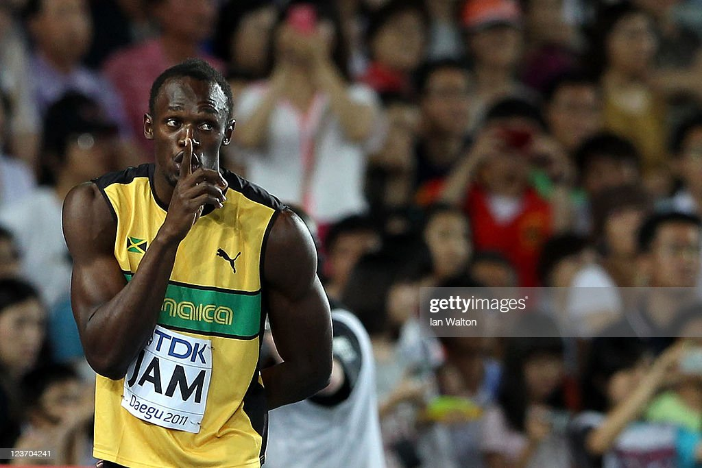 Usain Bolt of Jamaica gestures after claiming victory and a new world record in the men's 4x100 metres relay final during day nine of 13th IAAF World Athletics Championships at Daegu Stadium on September 4, 2011 in Daegu, South Korea.