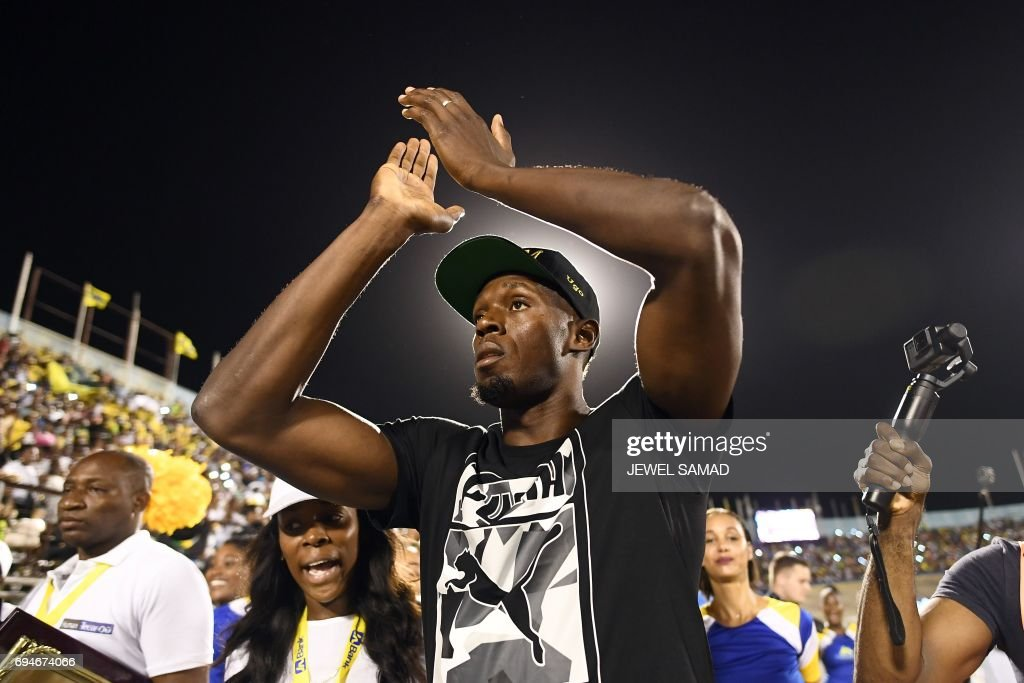 Usain Bolt of Jamaica greets the crowd at the national stadium before he runs 100m 'Salute to a Legend ' race during the Racers Grand Prix at the national stadium in Kingston, Jamaica, on June 10, 2017. The celebrations were in full swing for Usain Bolt's final race on home soil on June 10 with many Jamaicans saying they wish their favourite son could go on running forever. / AFP PHOTO / Jewel SAMAD