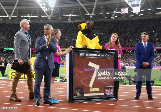 Usain Bolt of Jamaica is presented with a framed piece of the track from the London 2012 Olympics IAAF President Sebastian Coe and Mayor of London...