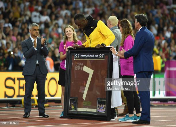 Usain Bolt of Jamaica is presented with a framed piece of the track from the London 2012 Olympics by IAAF President Sebastian Coe and Mayor of London...