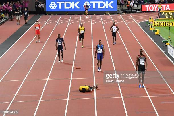 Usain Bolt of Jamaica lays on the track after falling in the Men's 4x100 Relay final during day nine of the 16th IAAF World Athletics Championships...