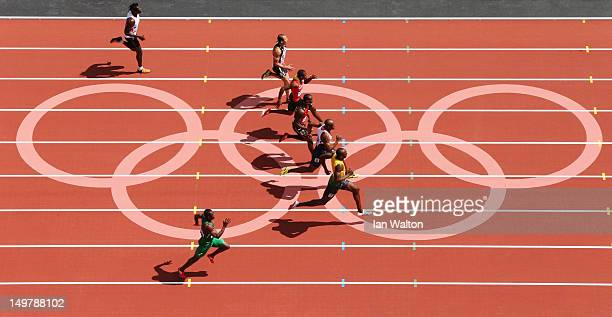 Usain Bolt of Jamaica leads James Dasaolu of Great Britain in the Men's 100m Round 1 Heats on Day 8 of the London 2012 Olympic Games at Olympic...