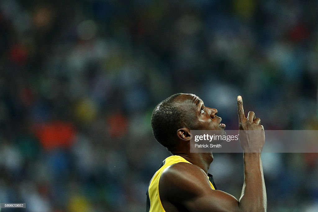 Usain Bolt of Jamaica points to the sky before winning the Men's 100 meter final on Day 9 of the Rio 2016 Olympic Games at the Olympic Stadium on...