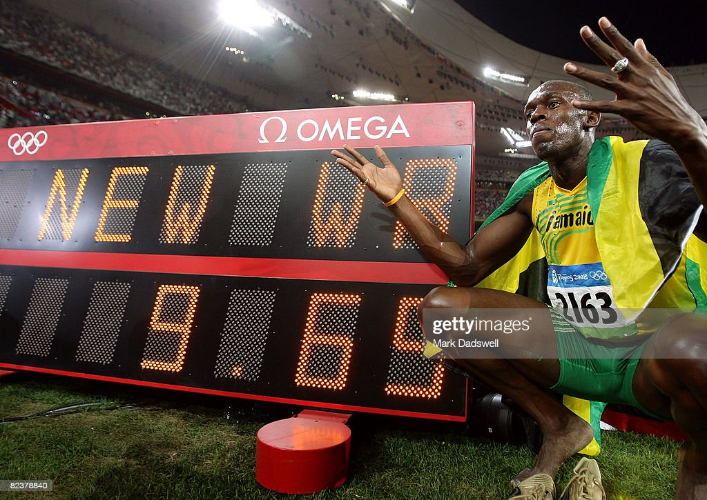 Usain Bolt of Jamaica poses by the clock displaying his winning time after the Men's 100m Final at the National Stadium on Day 8 of the Beijing 2008 Olympic Games on August 16, 2008 in Beijing, China. Bolt clocked a new world record time of 9.69 seconds.