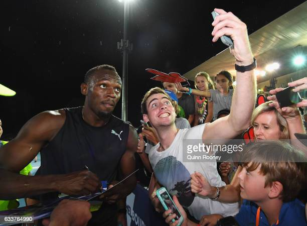 Usain Bolt of Jamaica poses for selfies after running in the relay during Nitro Athletics at Lakeside Stadium on February 4 2017 in Melbourne...
