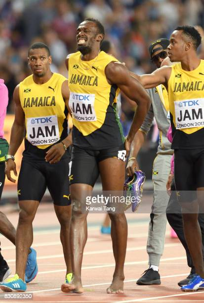 Usain Bolt of Jamaica pulls up during the Men's 4x100m Relay final during day nine of the 16th IAAF World Athletics Championships at the London...