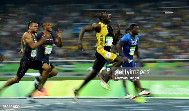 Usain Bolt of Jamaica races to win the Men's 100 meter final ahead of Justin Gatlin of the United States and Andre De Grasse of Canada on Day 9 of...