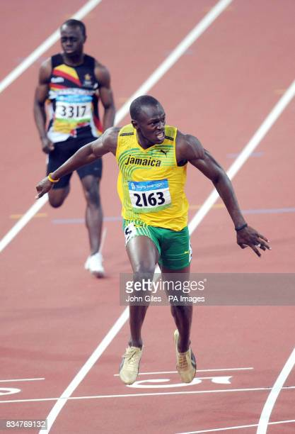 Usain Bolt of Jamaica reaches for the finish line as he wins the 200m gold medal in a world record time of 1930 seonds to complete a sprint double at...