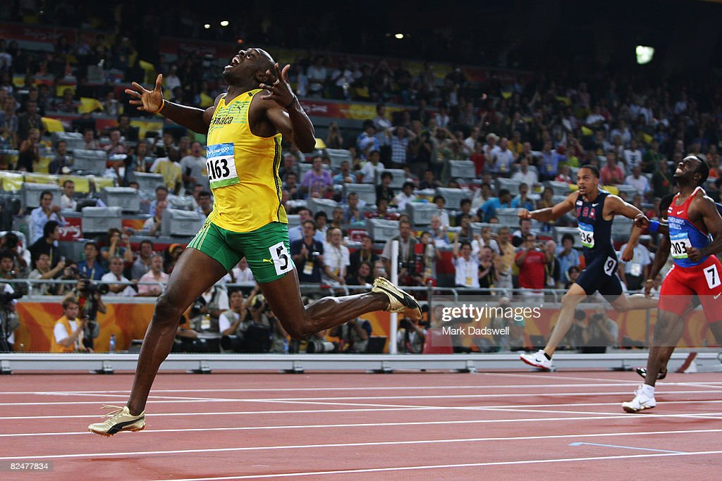 Usain Bolt of Jamaica reacts after breaking the world record with a time of 1930 to win the gold medal in the Men's 200m Final at the National...