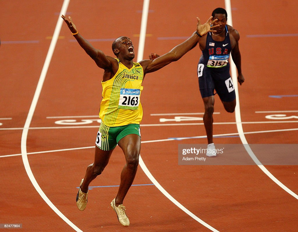 Usain Bolt of Jamaica reacts after breaking the world record with a time of 1930 to win the gold medal in the men's 200m final during the track and...