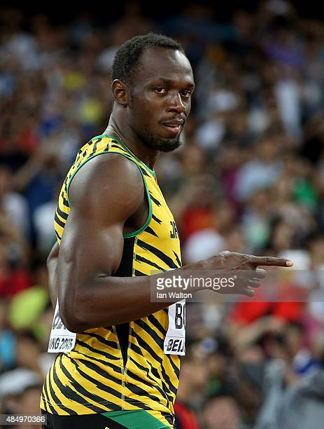 Usain Bolt of Jamaica reacts after crossing the finish line in the Men's 100 metres semifinal during day two of the 15th IAAF World Athletics...