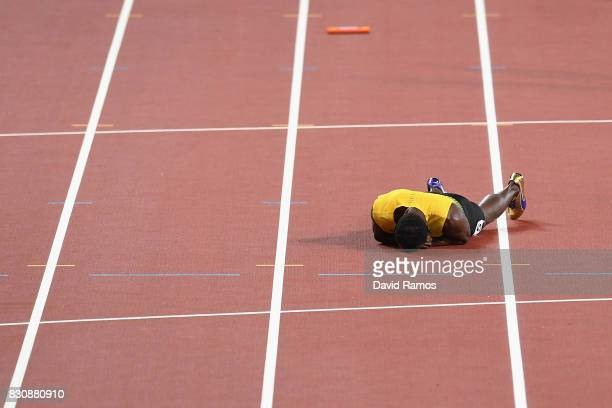 Usain Bolt of Jamaica reacts after falling to the track in the Men's 4x100 Relay final during day nine of the 16th IAAF World Athletics Championships...