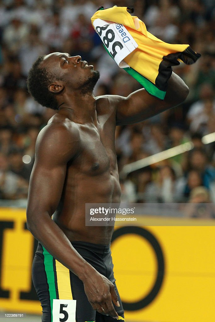 Usain Bolt of Jamaica reacts after false starting in the Men's 100 metre final during day two of 13th IAAF World Athletics Championships at the Daegu Stadium on August 28, 2011 in Daegu, South Korea.