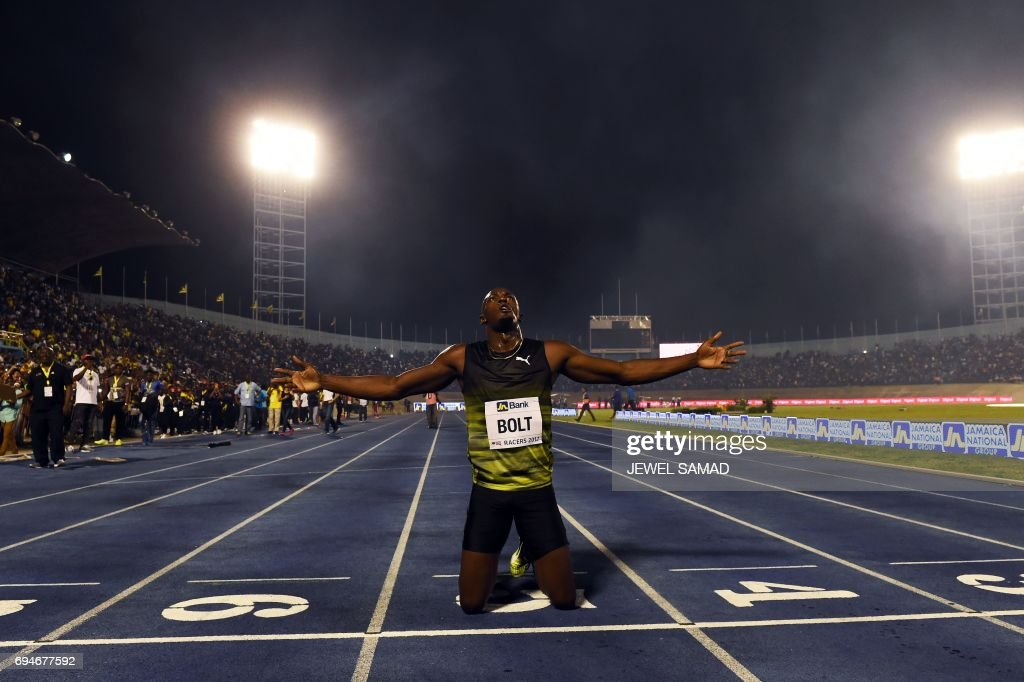 Usain Bolt of Jamaica reacts after winning 100m 'Salute to a Legend ' race during the Racers Grand Prix at the national stadium in Kingston, Jamaica, on June 10, 2017. Bolt partied with his devoted fans in an emotional farewell at the National Stadium on June 10 as he ran his final race on Jamaican soil. Bolt is retiring in August following the London World Championships. / AFP PHOTO / Jewel SAMAD