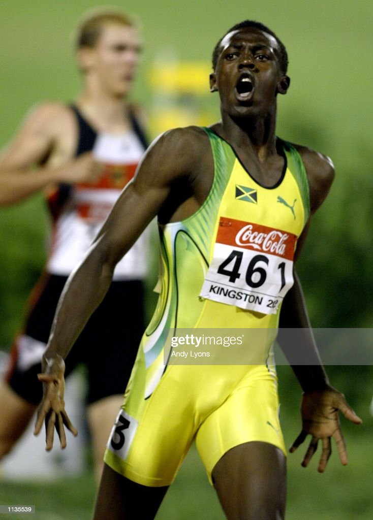 <a gi-track='captionPersonalityLinkClicked' href=/galleries/search?phrase=Usain+Bolt&family=editorial&specificpeople=604196 ng-click='$event.stopPropagation()'>Usain Bolt</a> of Jamaica reacts after winning the Mens 200 Meters during the IAAF Junior Athletics World Championships at the National Stadium on July18 , 2002 in Kingston, Jamaica.