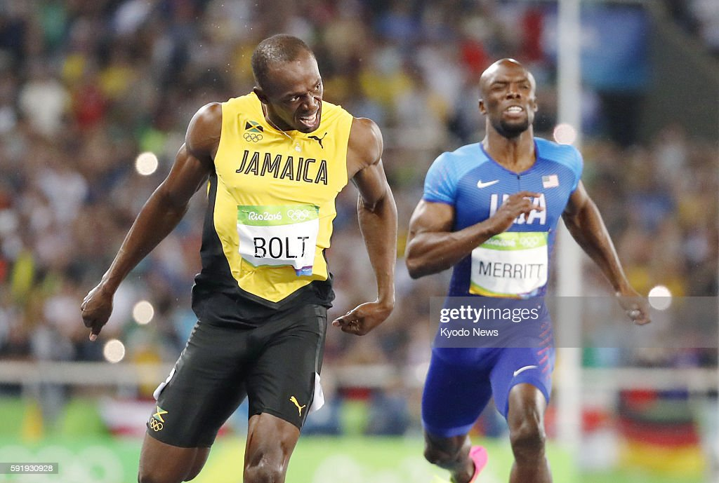 Usain Bolt of Jamaica reacts after winning the men's 200meter final at the Rio de Janeiro Olympics on Aug 18 alongside Lashawn Merritt of the United...