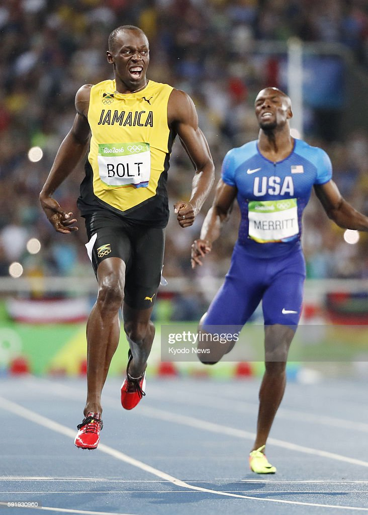 Usain Bolt of Jamaica reacts after winning the men's 200meter final at the Rio de Janeiro Olympics on Aug 18 with Lashawn Merritt of the United...
