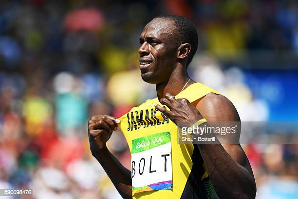 Usain Bolt of Jamaica reacts prior to competing in the Men's 200m Round 1 Heat 9 on Day 11 of the Rio 2016 Olympic Games at the Olympic Stadium on...