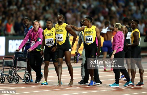 Usain Bolt of Jamaica receives attention after falling in the Men's 4x100 Relay final during day nine of the 16th IAAF World Athletics Championships...