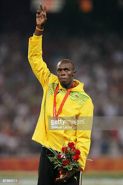 Usain Bolt of Jamaica receives the gold medal during the medal ceremony for the Men's 100m Final held at the National Stadium on Day 9 of the Beijing...