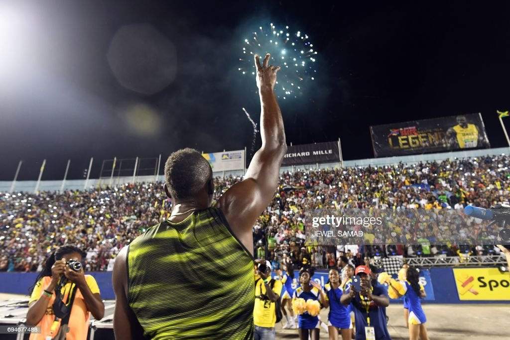 Usain Bolt of Jamaica salutes the crowd after winning 100m 'Salute to a Legend ' race during the Racers Grand Prix at the national stadium in Kingston, Jamaica, on June 10, 2017. Bolt partied with his devoted fans in an emotional farewell at the National Stadium on June 10 as he ran his final race on Jamaican soil. Bolt is retiring in August following the London World Championships. / AFP PHOTO / Jewel SAMAD