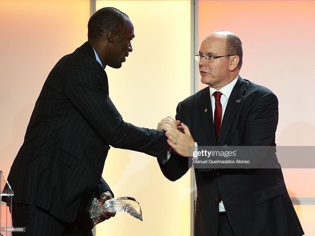 Usain Bolt (L) of Jamaica shakes hands with Prince Albert II of Monaco during the IAAF athlete of the year awards at the IAAF Centenary Gala on November 24, 2012 in Barcelona, Spain.
