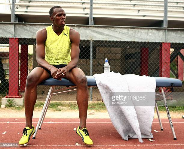 Usain Bolt of Jamaica sits on a massage table following a training session at the National Stadium on April 6 2009 in Kingston Jamaica