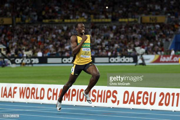 Usain Bolt of Jamaica sprints for the finish line to claim gold in the men's 200 metres final during day eight of the 13th IAAF World Athletics...