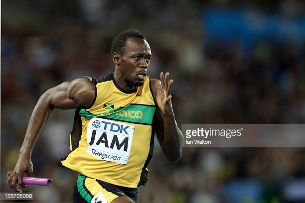 Usain Bolt of Jamaica sprints to victory and a new world record in the men's 4x100 metres relay final during day nine of 13th IAAF World Athletics...