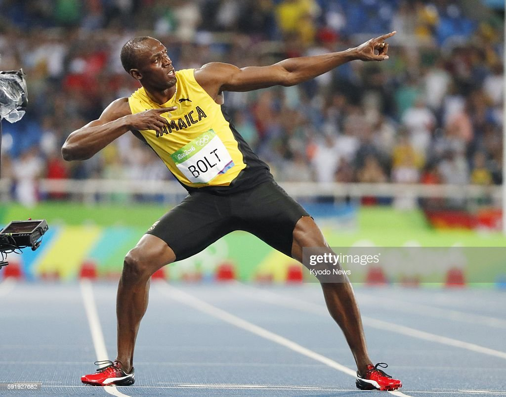 Usain Bolt of Jamaica strikes his signature 'Lightning Bolt' pose after winning the men's 200meter gold medal at the Rio de Janeiro Olympics on Aug...