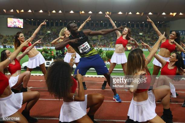 Usain Bolt of Jamaica struts his stuff alongside cheerleaders after victory in the men's 100m during the IAAF Diamond League Meeting Herculis on July...