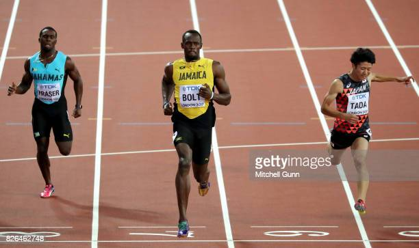 Usain Bolt of Jamaica winning the 1st round heat against Shuhei Tada of Japan and Warren Fraser of The Bahamas during day one of the 16th IAAF World...