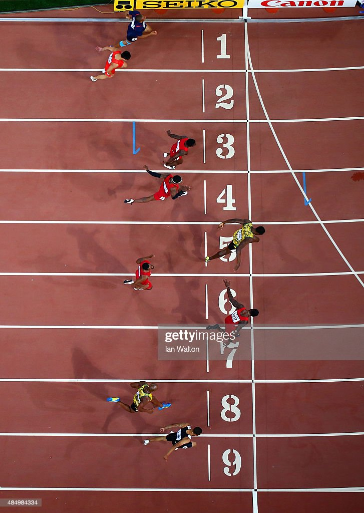 <a gi-track='captionPersonalityLinkClicked' href=/galleries/search?phrase=Usain+Bolt&family=editorial&specificpeople=604196 ng-click='$event.stopPropagation()'>Usain Bolt</a> of Jamaica (C) wins gold ahead of (L-R) Andre De Grasse of Canada, <a gi-track='captionPersonalityLinkClicked' href=/galleries/search?phrase=Asafa+Powell&family=editorial&specificpeople=240116 ng-click='$event.stopPropagation()'>Asafa Powell</a> of Jamaica, <a gi-track='captionPersonalityLinkClicked' href=/galleries/search?phrase=Justin+Gatlin&family=editorial&specificpeople=162752 ng-click='$event.stopPropagation()'>Justin Gatlin</a> of the United States, <a gi-track='captionPersonalityLinkClicked' href=/galleries/search?phrase=Tyson+Gay&family=editorial&specificpeople=543306 ng-click='$event.stopPropagation()'>Tyson Gay</a> of the United States, Mike Rodgers of the United States, <a gi-track='captionPersonalityLinkClicked' href=/galleries/search?phrase=Trayvon+Bromell&family=editorial&specificpeople=13398662 ng-click='$event.stopPropagation()'>Trayvon Bromell</a> of the United States, Bingtian Su of China and <a gi-track='captionPersonalityLinkClicked' href=/galleries/search?phrase=Jimmy+Vicaut&family=editorial&specificpeople=7124608 ng-click='$event.stopPropagation()'>Jimmy Vicaut</a> of France cross the finish line in the Men's 100 metres final during day two of the 15th IAAF World Athletics Championships Beijing 2015 at Beijing National Stadium on August 23, 2015 in Beijing, China.