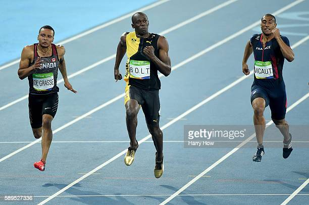 Usain Bolt of Jamaica wins the Men's 100 meter final ahead of Andre De Grasse of Canada and Jimmy Vicaut of France on Day 9 of the Rio 2016 Olympic...