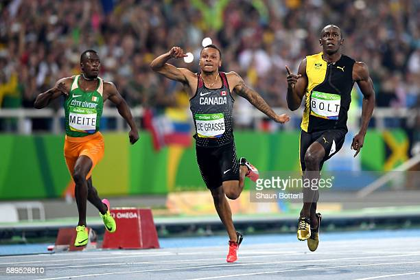 Usain Bolt of Jamaica wins the Men's 100m Final ahead of Andre De Grasse of Canada on Day 9 of the Rio 2016 Olympic Games at the Olympic Stadium on...