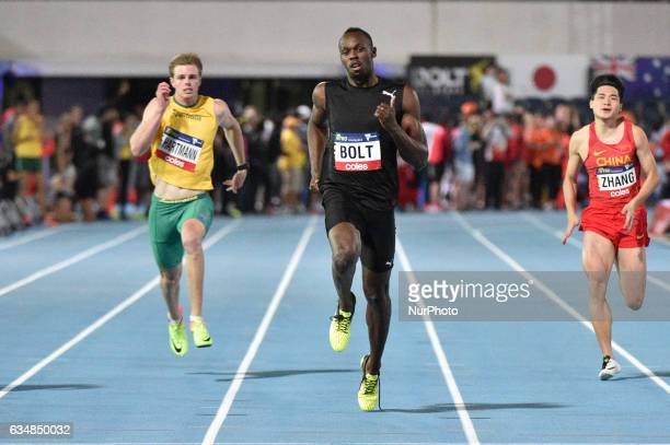 Usain Bolt of the Bolt All Stars leads Alex Hartmen of Australia and Ruixuan Zhang of China during the 150m sprint at Nitro Athletics at Lakeside...