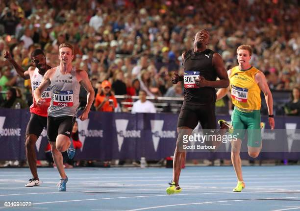 Usain Bolt of Usain Bolt's AllStar crosses the finish line to win the Mens 150 Metre Race as Hamish Gill of New Zealand and Alex Hartmann of...