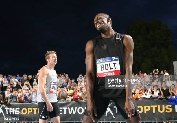 Usain Bolt of Usain Bolt's AllStar team celebrates after winning the Mens 150 Metre Race as Hamish Gill of New Zealand looks on during the Melbourne...