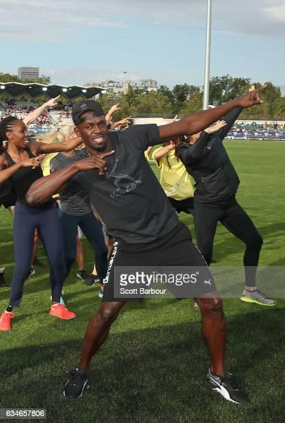 Usain Bolt of Usain Bolt's AllStar team dances as the teams enter the track during the Melbourne Nitro Athletics Series at Lakeside Stadium on...