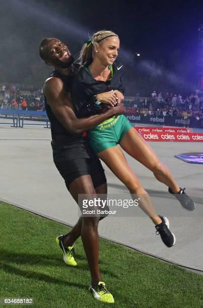 Usain Bolt of Usain Bolt's AllStar team hugs Genevieve LaCaze of Australia as he celebrates winning the event during the Melbourne Nitro Athletics...