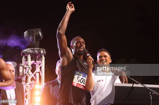 Usain Bolt of Usain Bolt's AllStar team sings on stage after winning the event as John Steffensen looks on during the Melbourne Nitro Athletics...