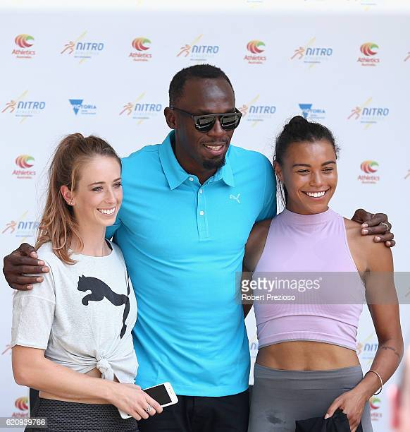 Usain Bolt poses with Australian Olympians Anneliese Rubie and Morgan Mitchell during the launch of Nitro Athletics on November 4 2016 in Melbourne...
