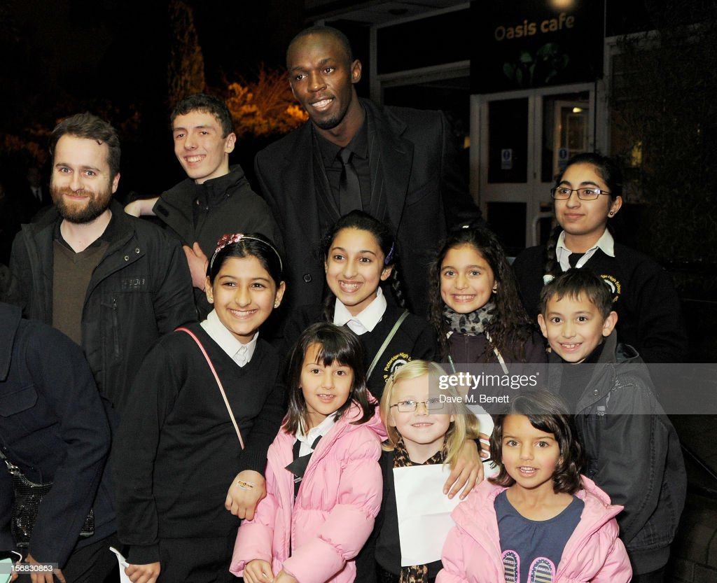 Usain Bolt poses with guests at the Zeitz Foundation and ZSL Gala at London Zoo on November 22, 2012 in London, England.