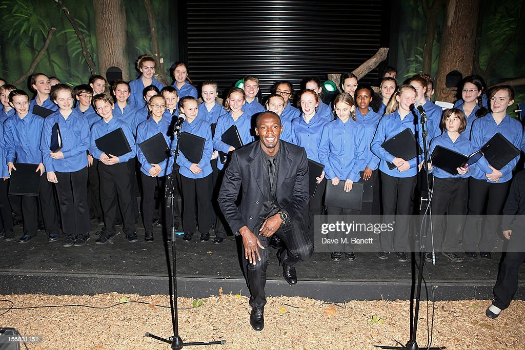 Usain Bolt poses with the children's choir at the Zeitz Foundation and ZSL Gala at London Zoo on November 22, 2012 in London, England.