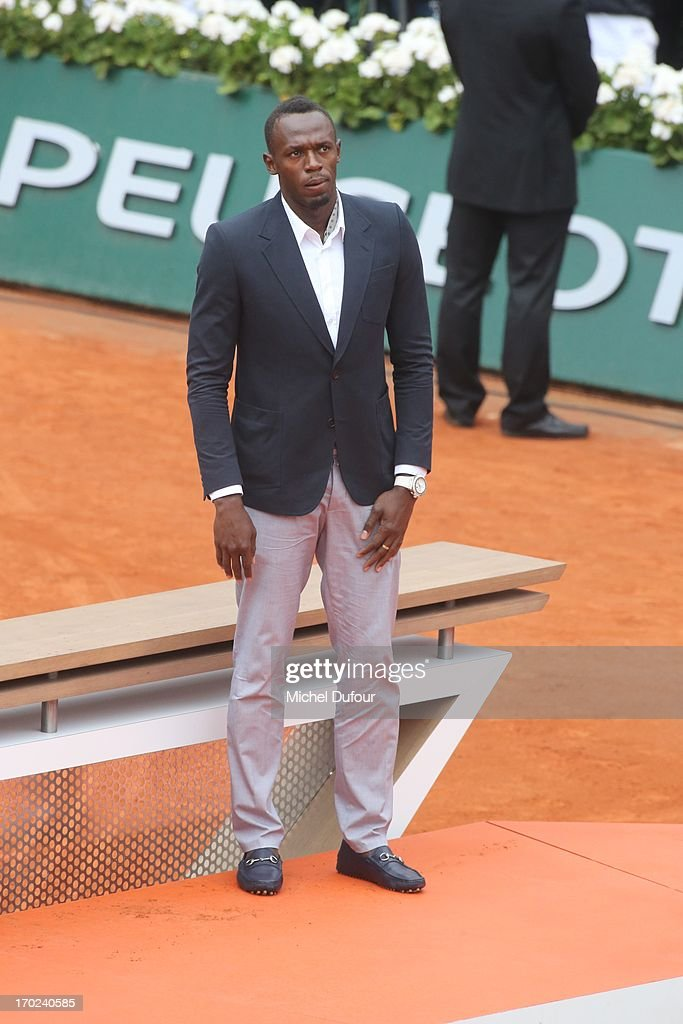 <a gi-track='captionPersonalityLinkClicked' href=/galleries/search?phrase=Usain+Bolt&family=editorial&specificpeople=604196 ng-click='$event.stopPropagation()'>Usain Bolt</a> seen as Celebrities At French Open 2013 - Day 15 at Roland Garros on June 9, 2013 in Paris, France.