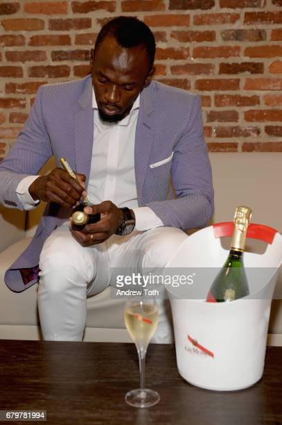 Usain Bolt signs bottles at GH Mumm and Usain Bolt's Toast to the Kentucky Derby on May 6 2017 in New York City