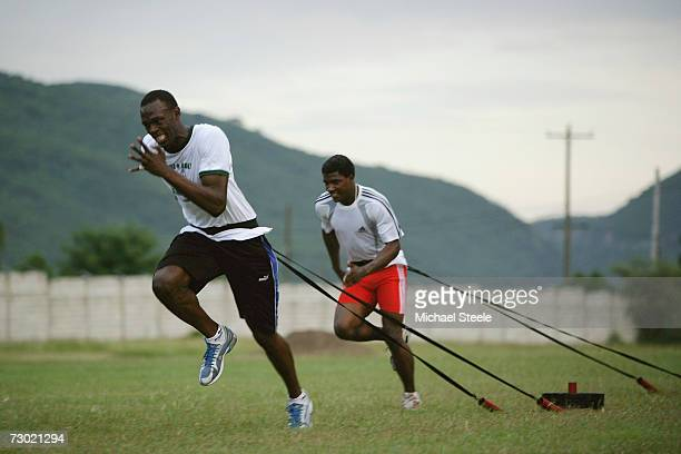 Usain Bolt the 200m and 400m sprinter works out during a training session at the University of West Indies on October 18 2006 in Kingston Jamaica