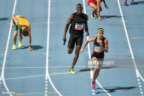 Usain Bolt top and Jeneba Tarmob of the Bolt All Stars during the 4x100m mixed really at Lakeside Stadium on February 11 2017 in Melbourne Australia