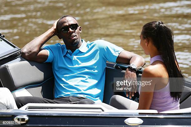 Usain Bolt travels by boat with Australian Olympian Morgan Mitchell to the launch of Nitro Athletics on November 4 2016 in Melbourne Australia