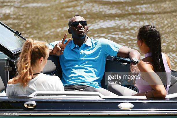 Usain Bolt travels by boat with Australian Olympians Anneliese Rubie and Morgan Mitchell to the launch of Nitro Athletics on November 4 2016 in...